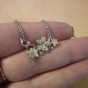 Tiny Silver Tone Flower And Leaf Necklace